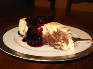 Chocolate Swirl Cheesecake with Triple Berry Sauce